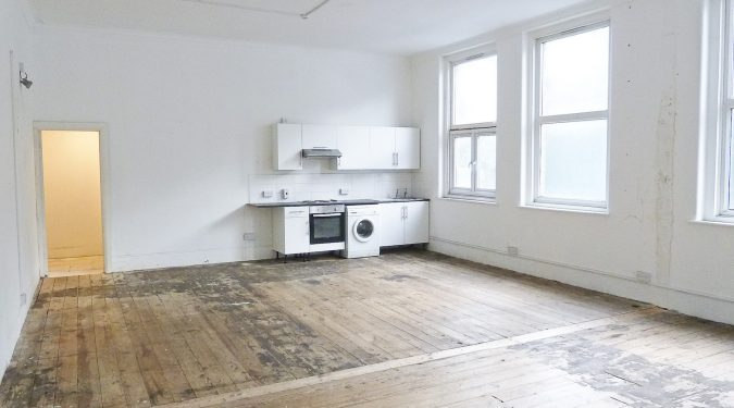 1000 sq ft 1st floor studio consists of 600 sq ft open space with 1 room, plus a kitchen area, WC and bath.